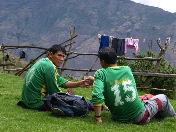 Sharing a glass of chicha in the mountains of Cusco, Peru - Matthew Barker