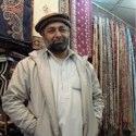 Shawl Shop Owner – Pakistan – Photo
