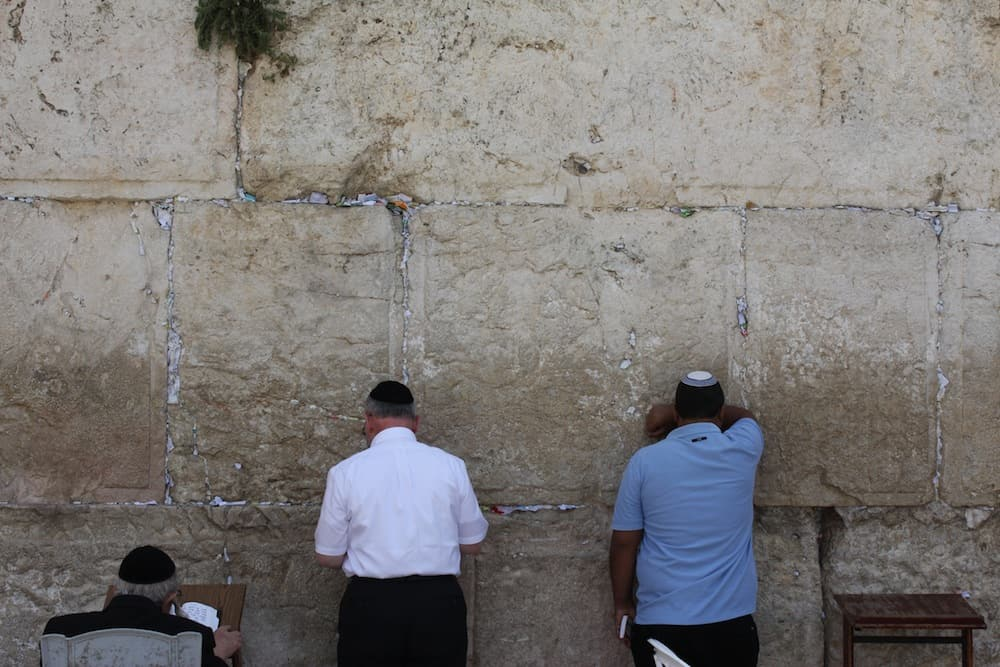 Men gather at one of Judaism's most holy sites, the Western Wall