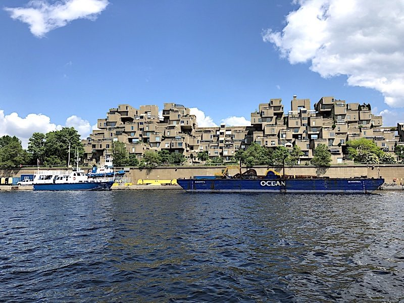The Habitat 67 housing complex facing the Old Port Montreal basin near the St. Lawrence River