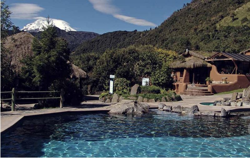 Caption Thermal springs of Papallacta with Antisana volcano in the backX